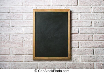 Chalk board on a white brick wall
