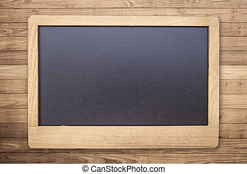 Chalk board on Brown wood plank wall texture background