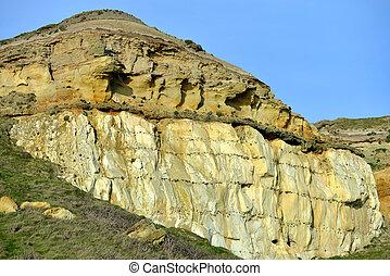 Cliffs showing strata of sandstone above chalk