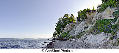 peeble coast and some chalk cliffs at the Baltic sea in the Jasmund national park on the island of Ruegen, Germany