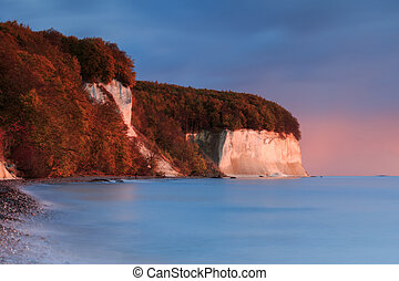 chalk cliffs on the baltic sea in autumn for sunrise
