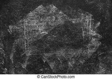 Chalk marks on dirty school blackboard