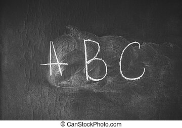 chalk written ABC on the blackboard