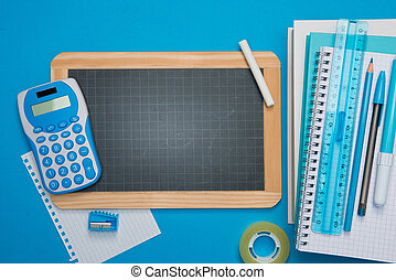 Chalkboard and stationery on blue background
