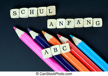 school beginning - Chalkboard and wood dice with the german...