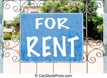 Chalkboard sign in front of house for rent