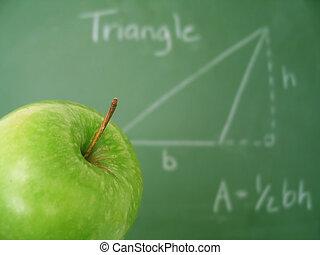 Chalkboard - Classroom chalkboard with math, apple in focus.