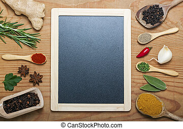 chalkboard menu on a wooden background with spices