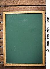 Chalkboard on a wooden table