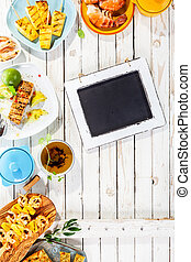 Chalkboard on Rustic Table with Grilled Dishes