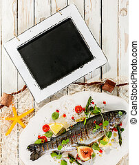 Chalkboard on Rustic Table with Whole Grilled Fish