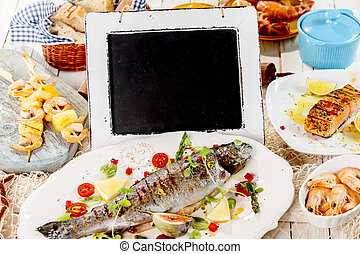 Chalkboard on Table with Grilled Seafood Meal