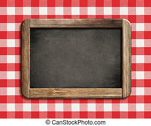 chalkboard or blackboard on picnic tablecloth