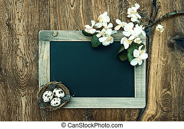 chalkboard with apple tree blossom and easter eggs decoration