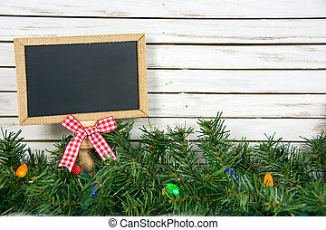 chalkboard with bow in Christmas pine