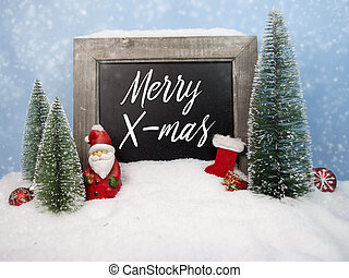 Chalkboard with christmas decoration with snow and snowflakes with message Merry X-Mas