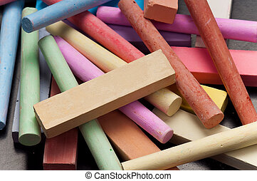 Chalkboard with colorful chalk - Close-up of colorful large ...
