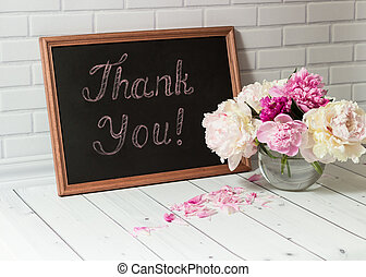 Chalkboard with inscription Thank You and peonies