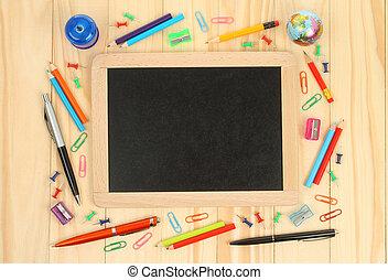 Chalkboard with school office supplies