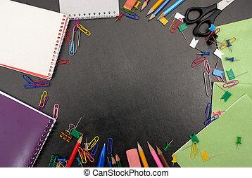 Chalkboard with school tools