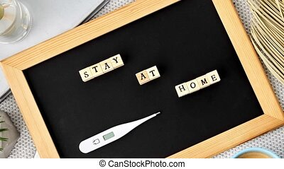 chalkboard with stay at home words on toy blocks - ...