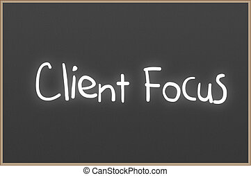 Chalkboard with text Client Focus - Chalkboard with wooden...