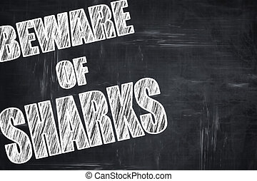 Chalkboard writing: Beware of sharks sign with some smooth lines