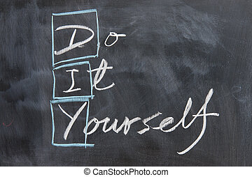 """Chalkboard writing - concept of DIY, """"do it yourself"""""""