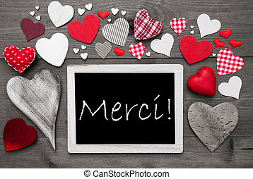 Chalkbord With Many Red Hearts, Merci Means Thank You