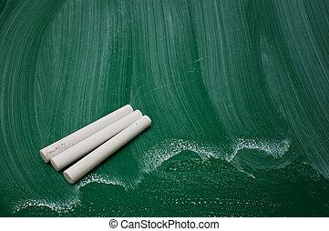 Chalks on green chalkboard