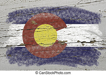 Chalky american state of colorado flag precisely painted with color chalk on grunge wooden texture