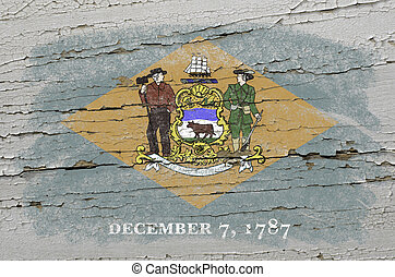 Chalky american state of delaware flag precisely painted with color chalk on grunge wooden texture