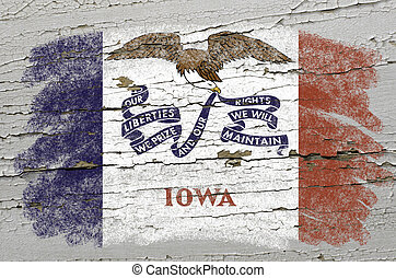 Chalky american state of iowa flag precisely painted with color chalk on grunge wooden texture