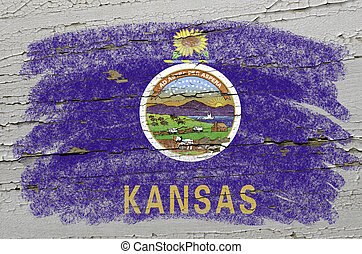 Chalky american state of kansas flag precisely painted with color chalk on grunge wooden texture