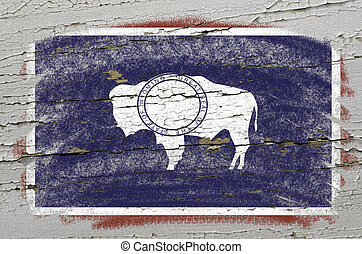 Chalky american state of wyoming flag precisely painted with color chalk on grunge wooden texture