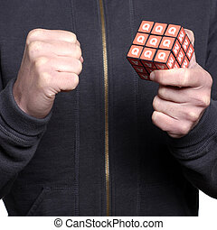 Man holding puzzle cube successfully completed.