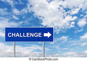 challenge on blue road sign