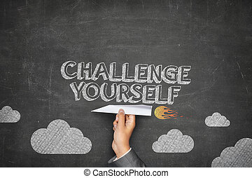 Challenge yourself concept on black blackboard with...