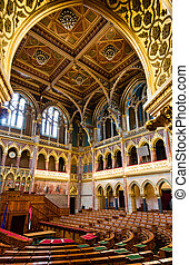 The Chamber of Congress in Hungarian Parliament, Budapest city. The chamber is decorated with wainscoted ceiling and marble lofts.
