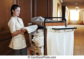 chambermaid at hotel - Hotel room service. female...