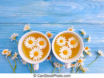 chamomile flower tea on wooden background
