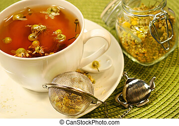 Chamomile  tea with white tea cup on green place mat