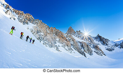 CHAMONIX, FRANCE - MARCH 19, 2016: A group of mountaneers on the Giant Glacier in the Mont Blanc massif, the highest mountain in Europe.