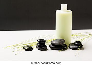 champú, botella, masaje, piedras, y, planta verde