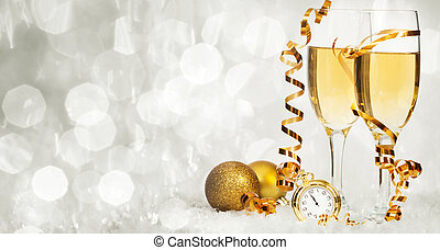 Champagne against holiday lights ang Christmas decorations -...