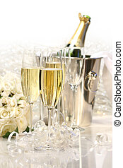 Champagne and a bouquet of roses - Glasses of champagne,...