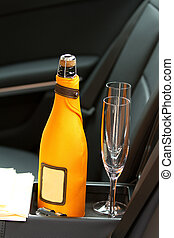 Champagne and glasses - bottle of champagne and two empty ...