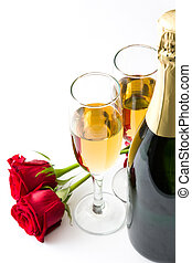 Champagne and roses on white background