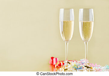 Champagne and Streamers on Gold - Two fluted champagne...