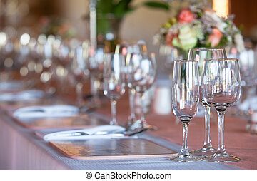 Champagne and wine glasses on decorated table at wedding reception